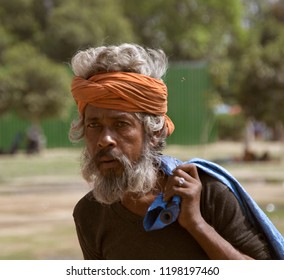 India, new Delhi - March 26, 2018: emphatic face of a gray-haired man with a beard in a head wound bandage characteristic of Indians