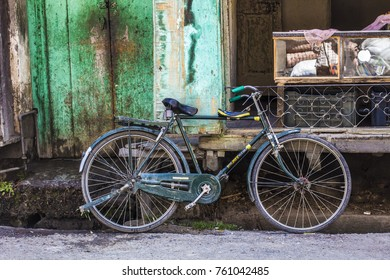 India - October 2017: Old rusty bicycle on the street of old town, India
