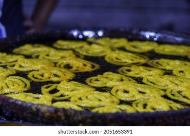 India, odisha- October 2021; jelebi deep fry on butter,jelebi is a famous sweetmeat in southwest asia and africa