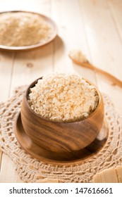 India organic basmati brown rice in wooden bowl on dining table.