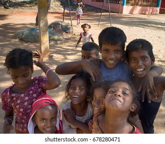 India, Puducherry - January 30, 2016: Daily life of India 13. Group of Indian kids different age jumps and plays in front of camera, group leader restores order