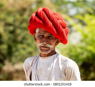 INDIA, RAJASTHAN - MARCH 08, 2020: Portrait of an elderly man of the Rabari ethnic group in a national headdress and traditional dress with national ornaments. India, Rajasthan, March 08, 2020.