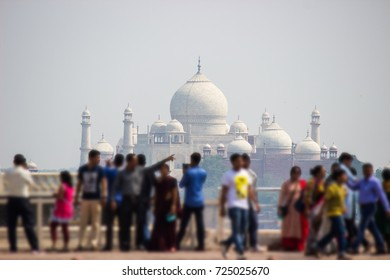 India Taj Mahal with blur of crowd of tourists enjoying walking around for take a photo.