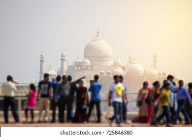 India Taj Mahal and sun light with blur of crowd of tourists enjoying walking around for take a photo.
