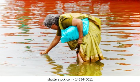 India, Varanasi - March 21, 2018: ablution in the sacred Ganges river. woman lavado