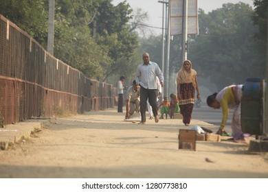 India, Vrindavan, November 2016. Pilgrims undergo Parikrama ritual at the sacred mountain Govardhan .  Hindu pilgrims walk barefoot  sand parikrama around Govardhan hill
