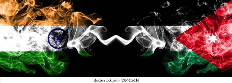 India vs Jordan, Jordanian smoke flags placed side by side. Thick colored silky smoke flags of Indian and Jordan, Jordanian