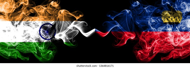 India vs Liechtenstein, Liechtensteins smoke flags placed side by side. Thick colored silky smoke flags of Indian and Liechtenstein, Liechtensteins