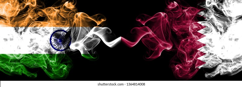 India vs Qatar, Qatari smoke flags placed side by side. Thick colored silky smoke flags of Indian and Qatar, Qatari