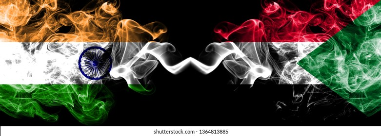India vs Sudan, Sudanese smoke flags placed side by side. Thick colored silky smoke flags of Indian and Sudan, Sudanese