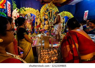 India, West Bengal, Canning - 09.10.2016 - Sondhi Pujo the most sacred moment of Durga Puja Festival.  The time when the good take the control over evil. The moment the evil Asura) killed by Godess