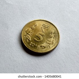 Indian 5 rupees coin, isolated, golden color.