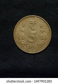 Indian 5 rupees coin on dark background