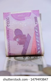 Indian 500, 2000 rupee notes,  Indian currency note Folded on white background with space for text