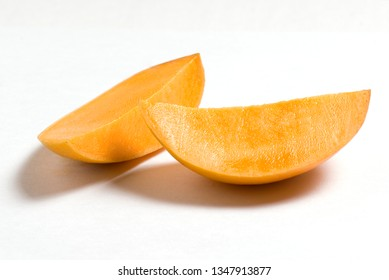 Indian Alphonso mango fruits slice isolated on a white background