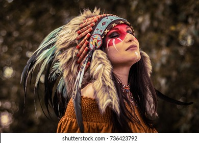 indian american female shaman with closed eyes horizontal