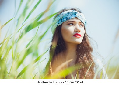 Indian american woman portrait in the grass