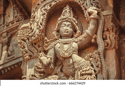 Indian Architecture of 12th century. Woman dancing in traditional style on stone sculptured decoration inside the Hindu temple Hoysaleshwara in Halebidu, India