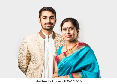 Indian asian old Mother and adult son in traditional wear, standing isolated over white background