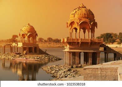 Indian attractions. Bright sunlight, the salt light streaming over the Gadi Sagar temple on Lake Gadisar Jaisalmer, Rajasthan, north India.