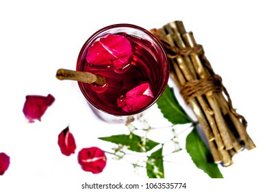 Indian Ayurvedic and Islamic way of doing brush with using miswak or siwak or Neem bark with rose water isolated on white.