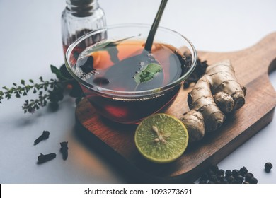 Indian Ayurvedic Kadha/Karha or health tonic for fighting seasonal infections, made using ginger, tulsi, black pepper, clove and honey. Selective focus