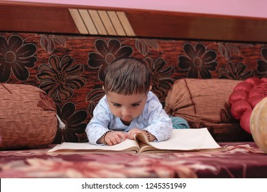 indian baby girl with book