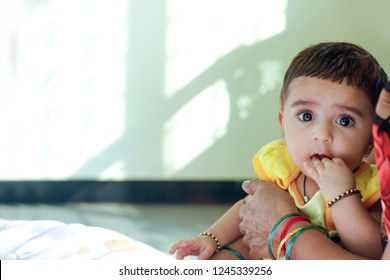 Indian baby girl with cellphone