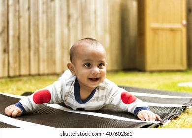 Indian baby playing in garden