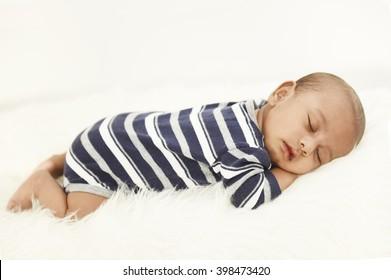 An Indian baby sleeping