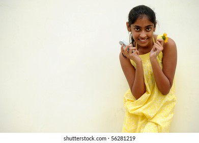 indian beautiful girl posing at outdoor yellow wall