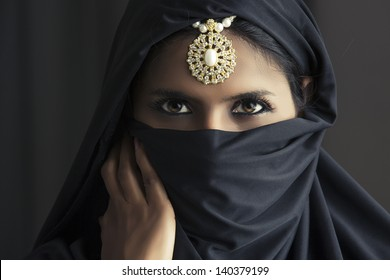 Indian beautiful Muslim girl portrait showing her eyes only.