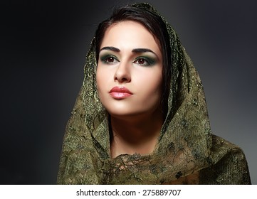 Indian beauty face close up perfect make up headscarf. Series. young beautiful brunette in traditional national dress