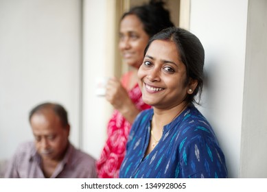Indian Bengali beautiful father, mother and daughter are having quality leisure time on balcony. Indian family and lifestyle