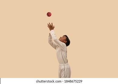 Indian Boy catching cricket ball