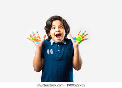 indian boy with painted palm or hands, standing isolated against white background
