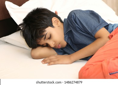 Indian boy sleeping in bed at home
