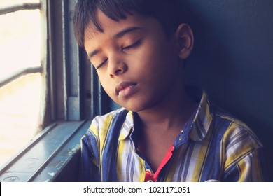 Indian Boy Sleeping in Train