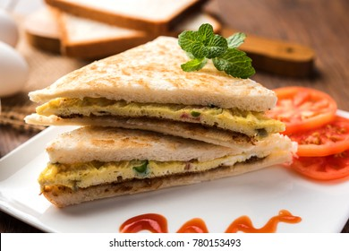 Indian Bread Omelette/Omelet sandwich served with tomato ketchup. Med up of Hen egg. Served over moody background. selective focus