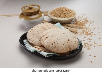 indian bread with wheat grains in background