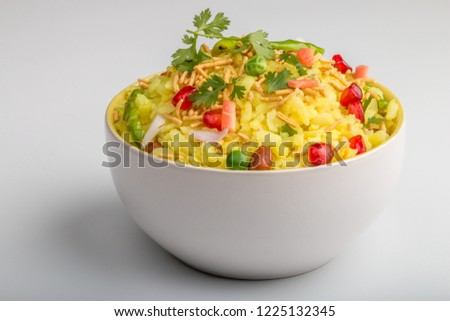 Indian breakfast Poha topped