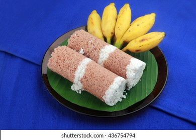 Indian breakfast Puttu with curry and a bunch of banana.