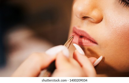 Indian bridal being assisted by makeup artist Karachi, Pakistan, May 01, 2019