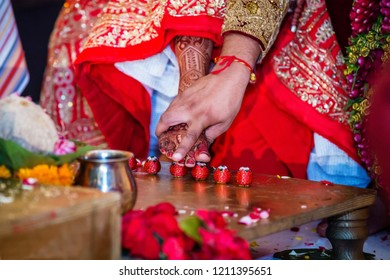 Indian Bridal feet on betel seven nut and Groom touching Bride feet