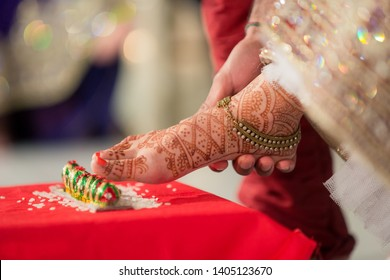 Indian Bridal feet on betel nut and Groom's touching Bridal feet