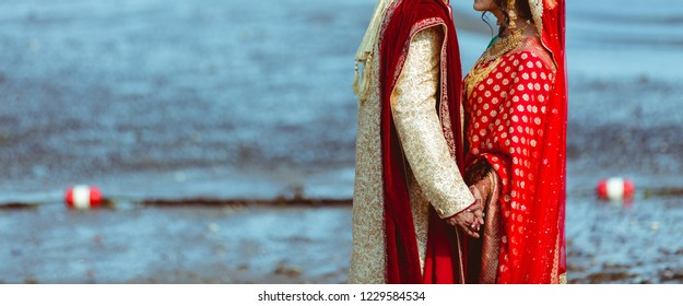 Indian Bridal and groom holding hand her wedding day