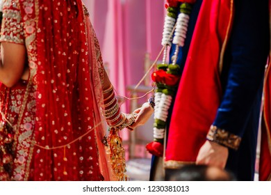 Indian Bridal and groom holding hand during the ritual ceremony