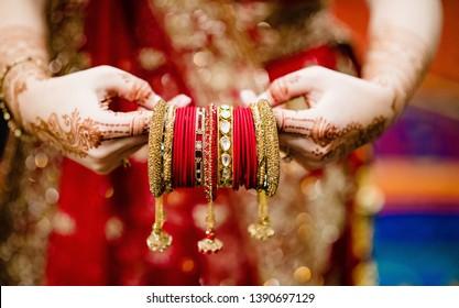 Indian bridal holding wedding bangles her wedding day