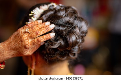 Indian bridal showing er hair style and mehndi design