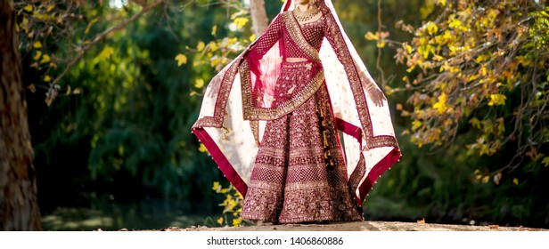 Indian bridal showing wedding dress and veils